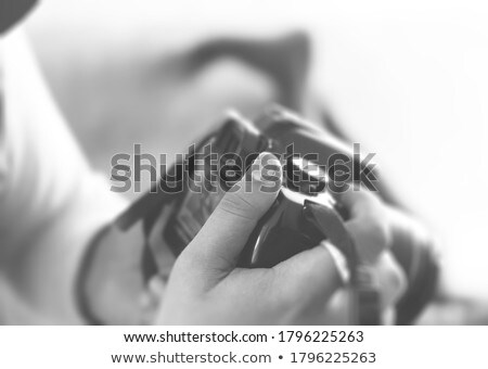 Handsome guy with a digital camera (shallow DoF) Stock photo © Nejron
