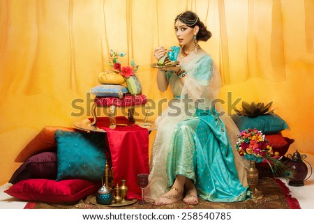 Beautiful Woman In Arabic Costume Sitting On Pillows Stok fotoğraf © Svetography
