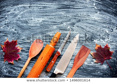 Cutlery old wooden table sprinkled with flour. Stock photo © justinb