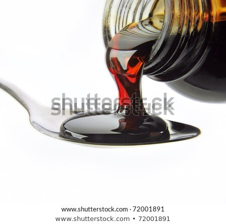 Close up of medicine bottle with red syrup and spoon isolated on Stock photo © tetkoren