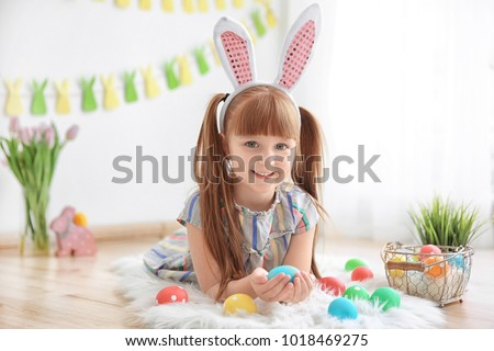 Little girl lying on rug with rabbit Stock photo © wavebreak_media