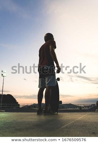 Gördeszkás naplemente illusztráció jókedv sziluett gördeszka Stock fotó © adrenalina