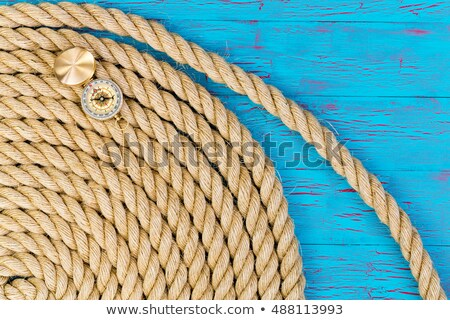 Thick rope and open directional compass Stock photo © ozgur