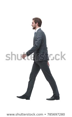 Vista lateral empresario caminando blanco teléfono azul Foto stock © wavebreak_media