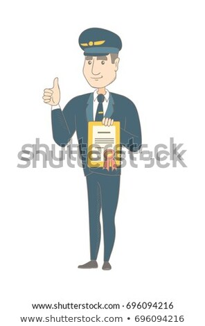 Young caucasian pilot holding a certificate. Stock photo © RAStudio