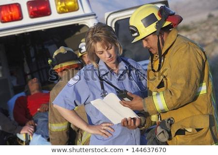 Paramedic reading medical report Stock photo © wavebreak_media