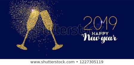 Nowy rok niebieski blask szkła toast karty Zdjęcia stock © cienpies