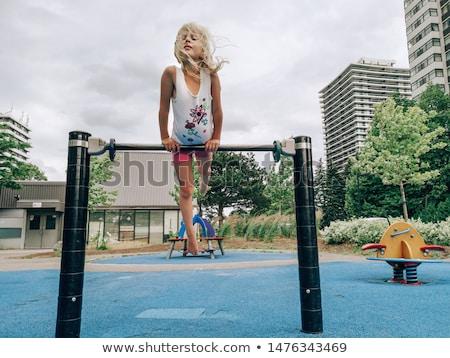 Children playing and climbing up the bars Stock photo © colematt