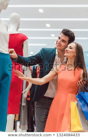 Pár új divat butik néz ruha Stock fotó © Kzenon