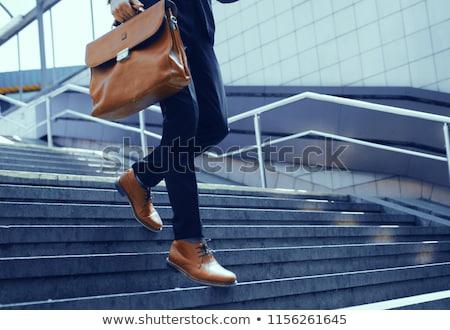 Obraz młodych człowiek biznesu teczki spaceru schody Zdjęcia stock © deandrobot