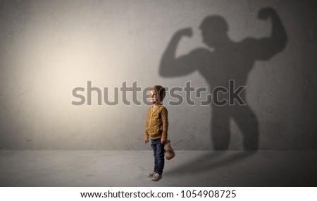 Cute kid with hero shadow behind Foto stock © ra2studio