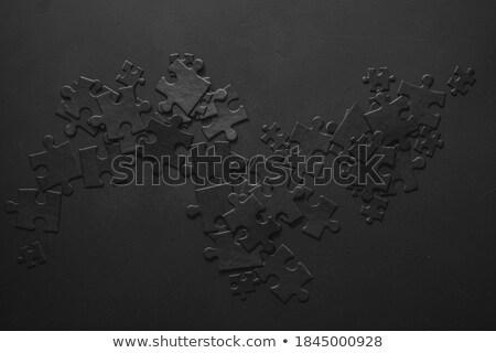 Fekete kirakó darabok asztal 3d illusztráció partner csapatmunka Stock fotó © limbi007
