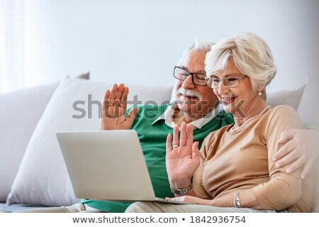 Side view of a senior couple interacting with each other on dining table at home Stock photo © wavebreak_media