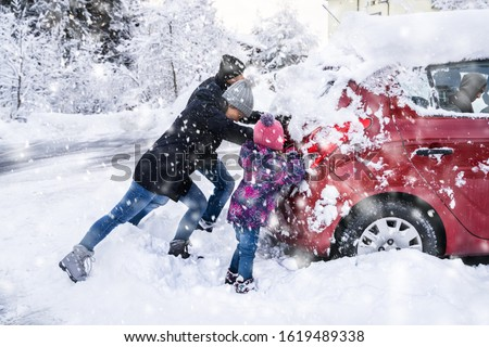 Family Pushing A Car Stuck In The Snow Stock photo © AndreyPopov