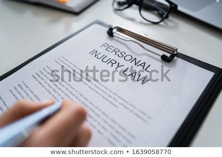 Papier persoonlijke letsel recht vrouw Stockfoto © AndreyPopov