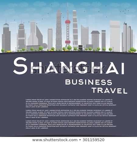 Xangai linha do horizonte blue sky cinza arranha-céus reflexões Foto stock © ShustrikS