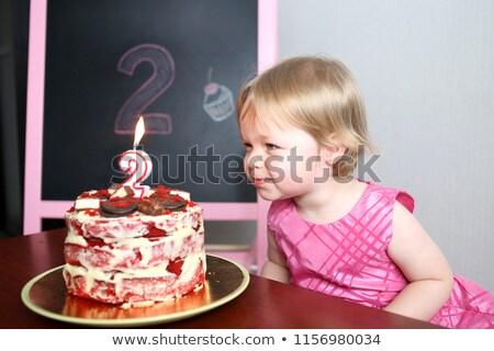 Two toddlers with birthday cake Stock photo © Kzenon