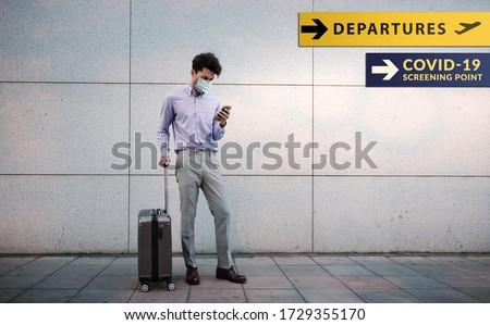 Empresario maleta mascarilla quirúrgica gris traje sesión Foto stock © nito
