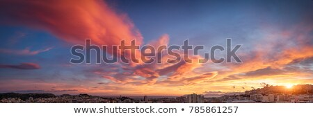 sunset over city stock photo © petrmalyshev