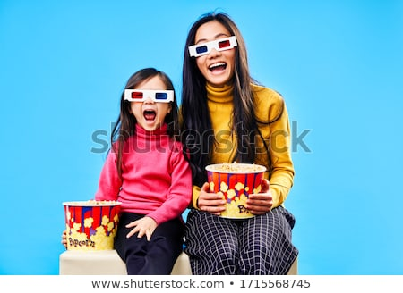 Stok fotoğraf: Güzel · genç · kadın · izlerken · gözlük · mutlu · genç
