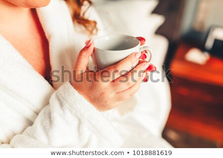 A brunette in the morning with hairroller on. Stock photo © photography33