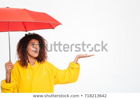 Mujer espera lluvia azul impermeable Foto stock © grafvision