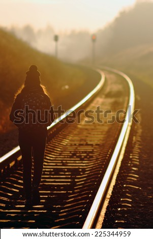 young girl walking along railway tracks stock photo © rhamm
