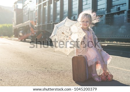 little girl with umbrella and suitcase on railroad Stock photo © goce