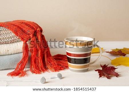 Knit striped scarf on wood table Stock photo © nalinratphi