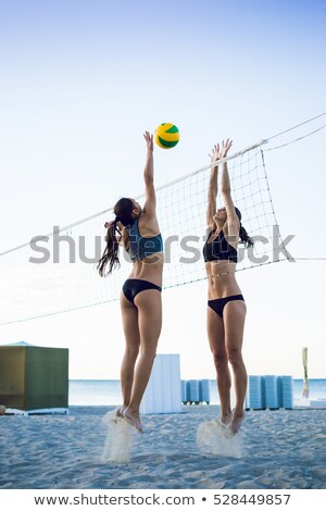 young woman with volleyball ball and net on beach Stock photo © dolgachov