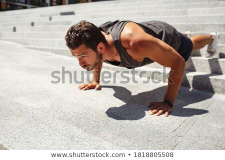 Man doing push-up as sport for better fitness Stock photo © Kzenon