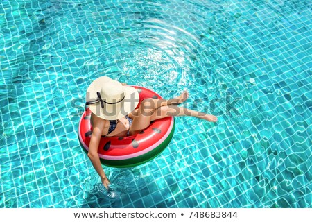 Model in rubber ring in swimming pool Stock photo © bezikus