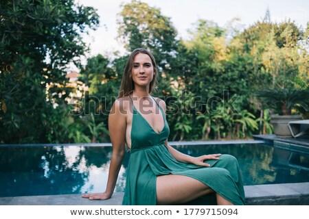 Sedutor loiro senhora relaxante trópicos mulher Foto stock © konradbak