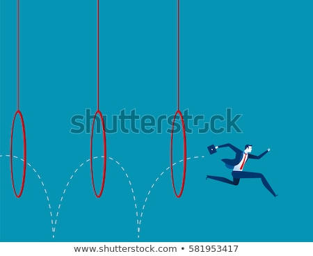 Jumping through hoops Stock photo © bluering