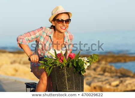 Carefree pretty woman with bicycle riding on a wooden path at th Stock photo © vlad_star