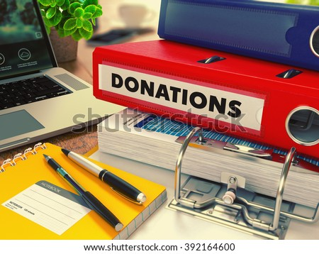 Red Office Folder with Inscription Donations. Stock photo © tashatuvango