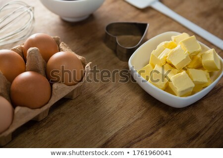 Eggs, butter cubes, whisk and cookie cutter on a wooden table Stock photo © wavebreak_media