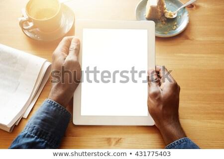 joven · negro · tableta · aislado · blanco - foto stock © deandrobot