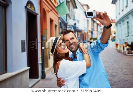happy couple taking selfie photo with a photo camera stock photo © lopolo