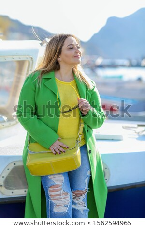 Tourist in the seaport in early spring on a bright Sunny day Stock photo © ElenaBatkova