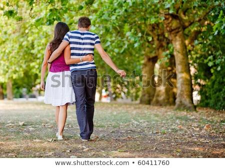 Heteroszexuális pár együtt park séta virág fa Stock fotó © ElenaBatkova
