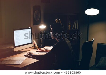 asian hacker in dark room with computers at night Stock photo © dolgachov