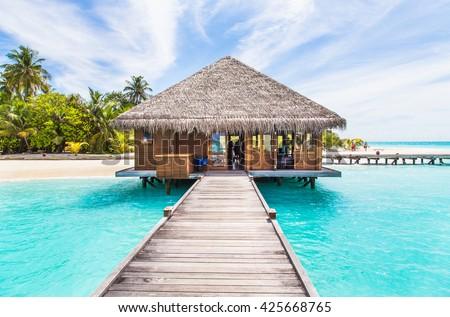 Su Maldivler 24 ahşap köprü tropikal plaj Stok fotoğraf © bloodua