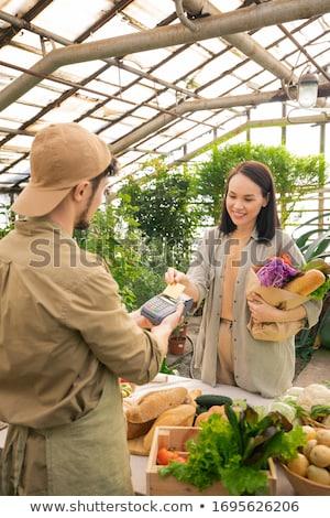 Asia mujer pago comestibles retrato Foto stock © vichie81