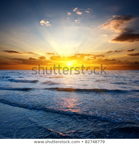 dramatic sunset on ocean stock photo © simplefoto