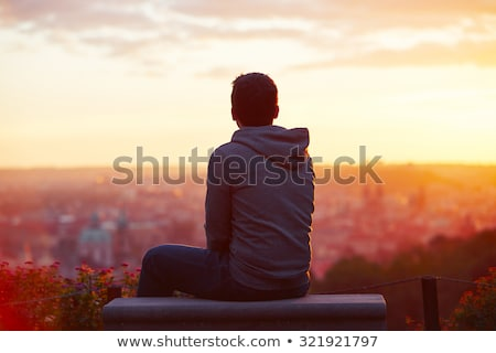Moço sessão ao ar livre jovem homem casual Foto stock © JamiRae