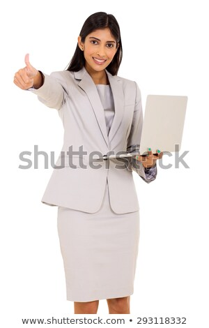 Businesswoman holding a laptop and giving the thumb's up Stock photo © photography33