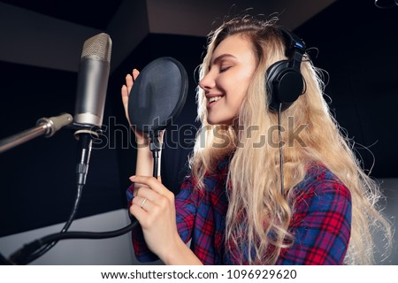 Close up of a gorgeous singer recording a track in a studio Stock photo © wavebreak_media