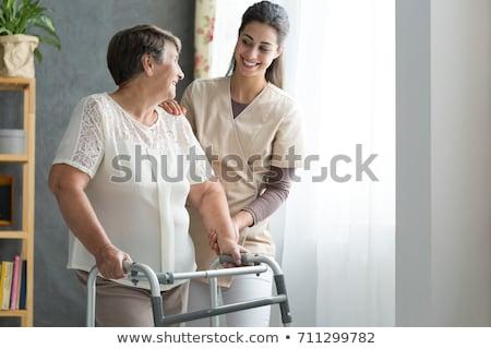 öregasszony öregek otthona idős nő törött karok mosolyog Stock fotó © Lighthunter