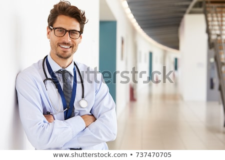 male doctor smiling with arms crossed stock photo © stockyimages